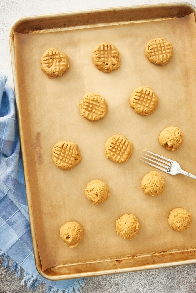 Peanut Butter Cookies dough on a parchment-lined baking sheet
