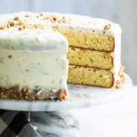 Butter Pecan Cake on a marble cake stand
