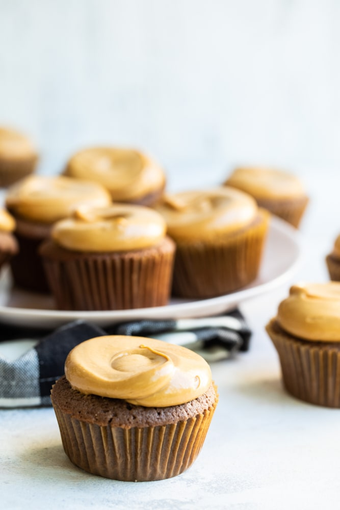 Mexican Chocolate Cupcakes with Dulce de Leche Frosting on a light-colored surface