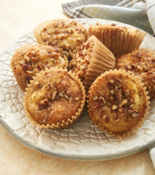 Banana Cream Cheese Muffins on a patterned white plate