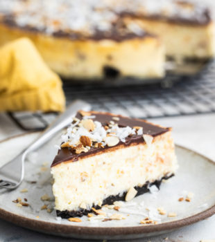 slice of Chocolate Coconut Almond Cheesecake on a beige plate