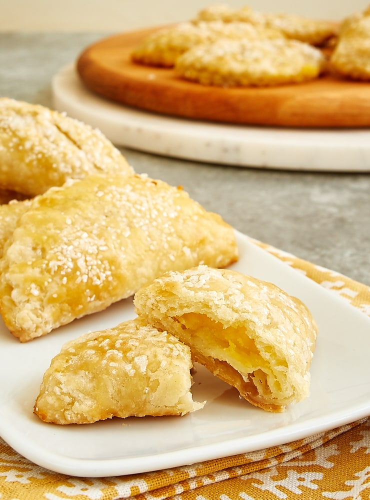 Ginger Lemon Hand Pie cut in half on a white serving plate