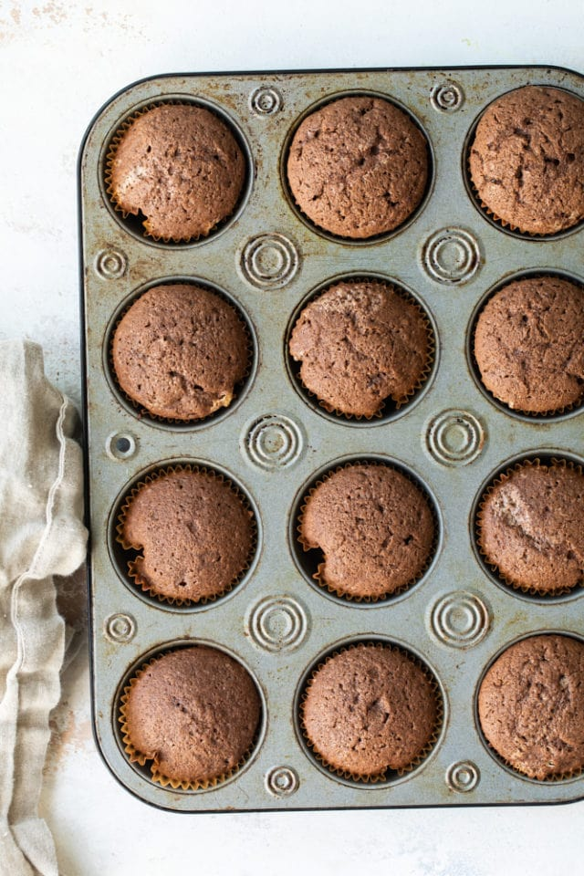overhead view of baked Mexican Chocolate Cupcakes in a muffin pan