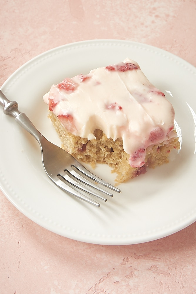 slice of Strawberry Sheet Cake on a white plate