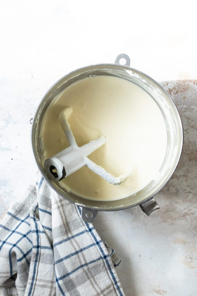 overhead view of cheesecake batter in a mixing bowl
