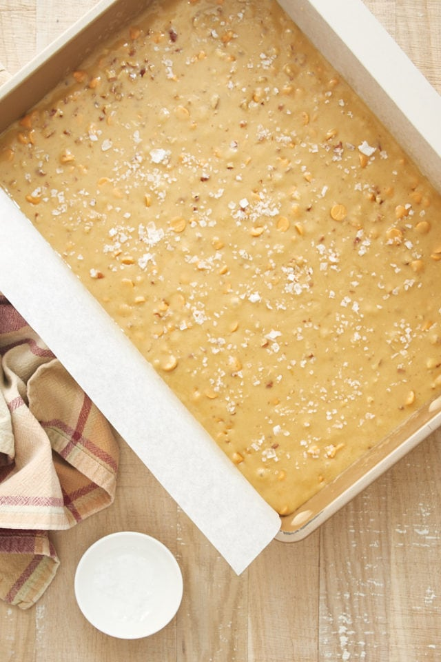 overhead view of Salted Butterscotch Blondies batter in a parchment-lined baking pan