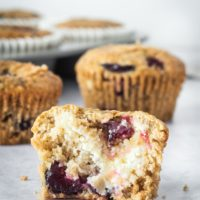 a Cherry Cheese Muffins cut in half to show the cream cheese filling