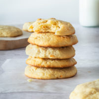 stack of Cream Cheese Macadamia Cookies on wax paper