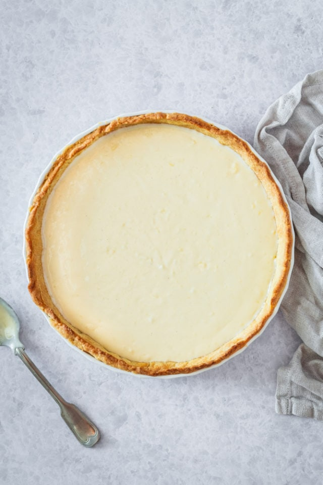 overhead view of pie crust filled with pastry cream