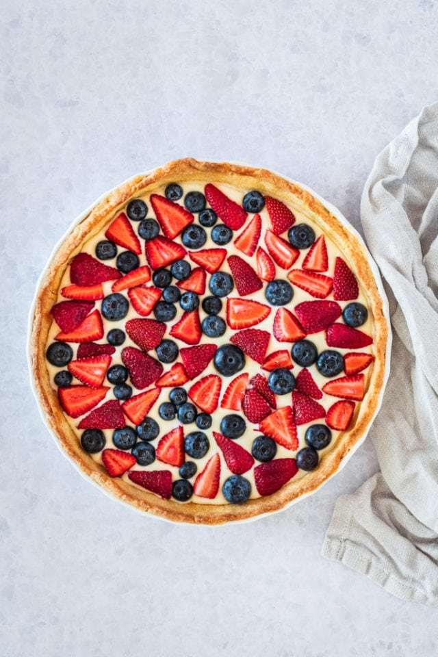 overhead view of Fresh Berry Tart in a white pie plate