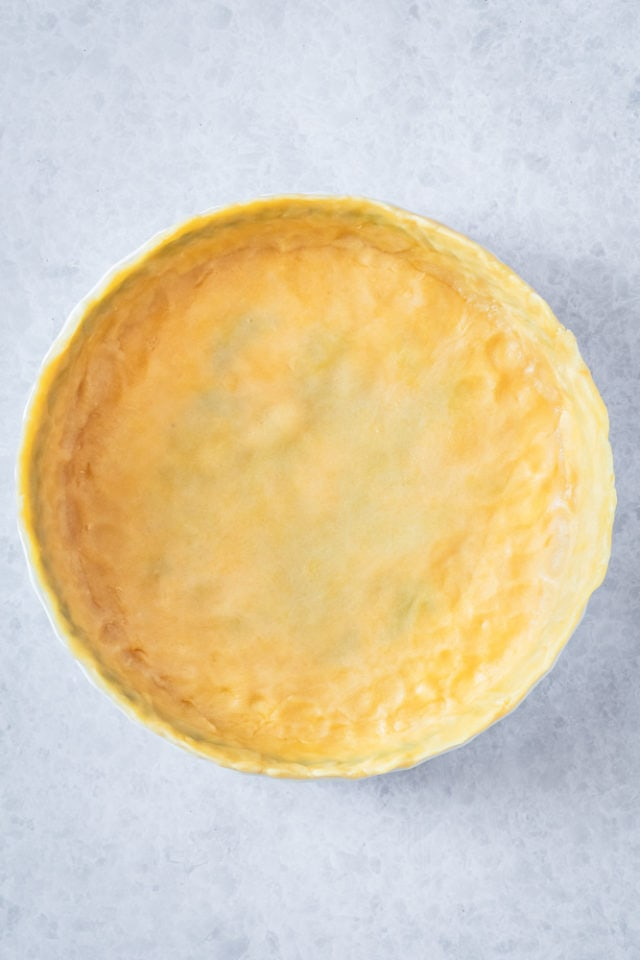 overhead view of unbaked crust in a pie plate