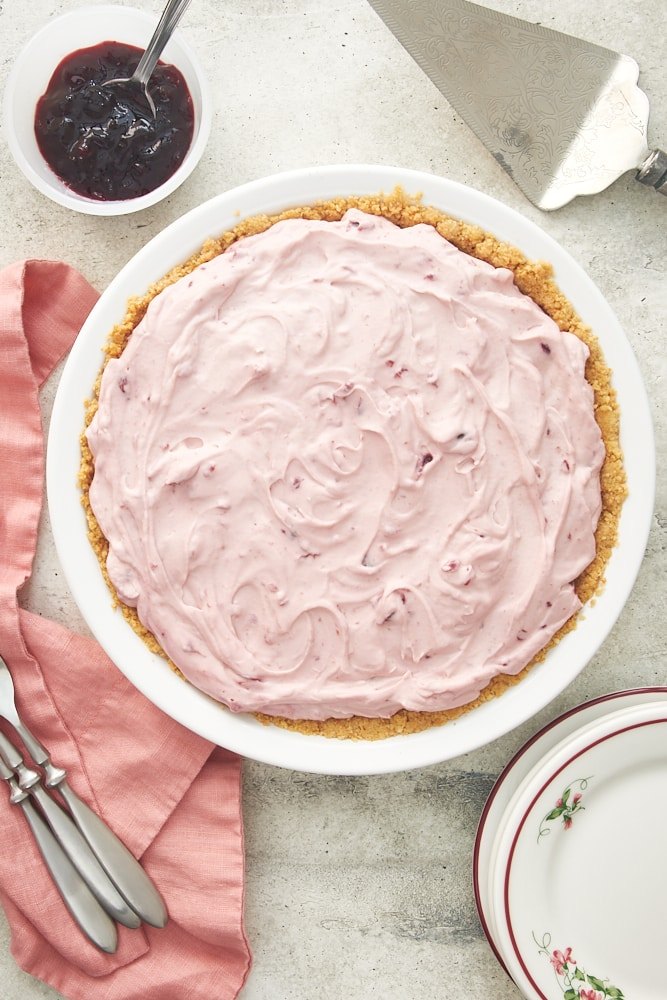 overhead view of No-Bake Cherry Cheesecake Pie in a white pie plate