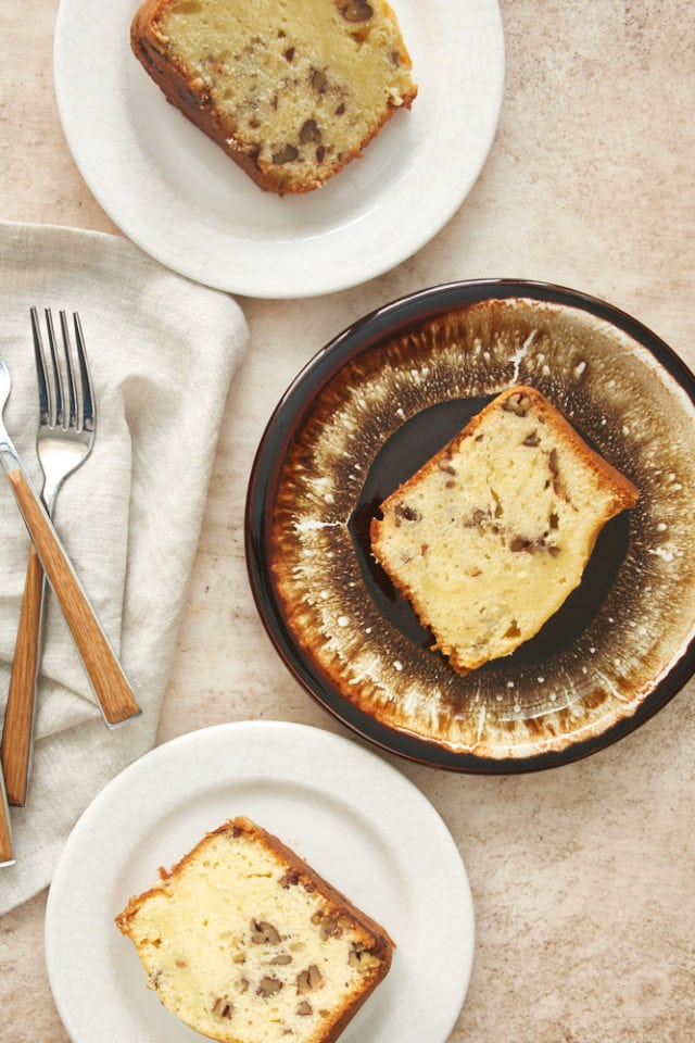 overhead view of slices of pound cake on white and brown plates