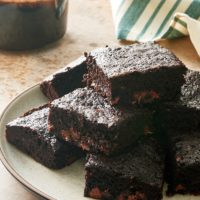 Double Chocolate Zucchini Brownies on a beige plate