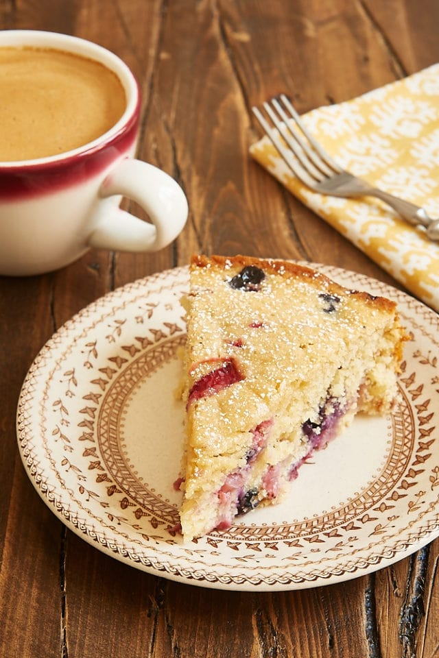slice of Berry Muffin Cake on a floral-rimmed beige plate