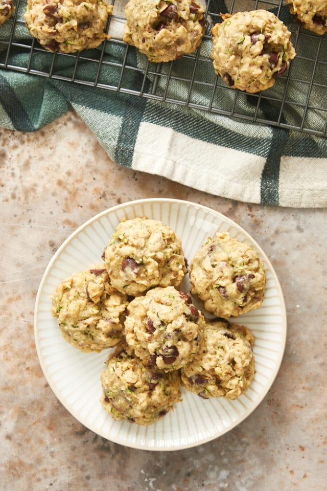 overhead view of Zucchini Oatmeal Chocolate Chip Cookies on a white and beige plate