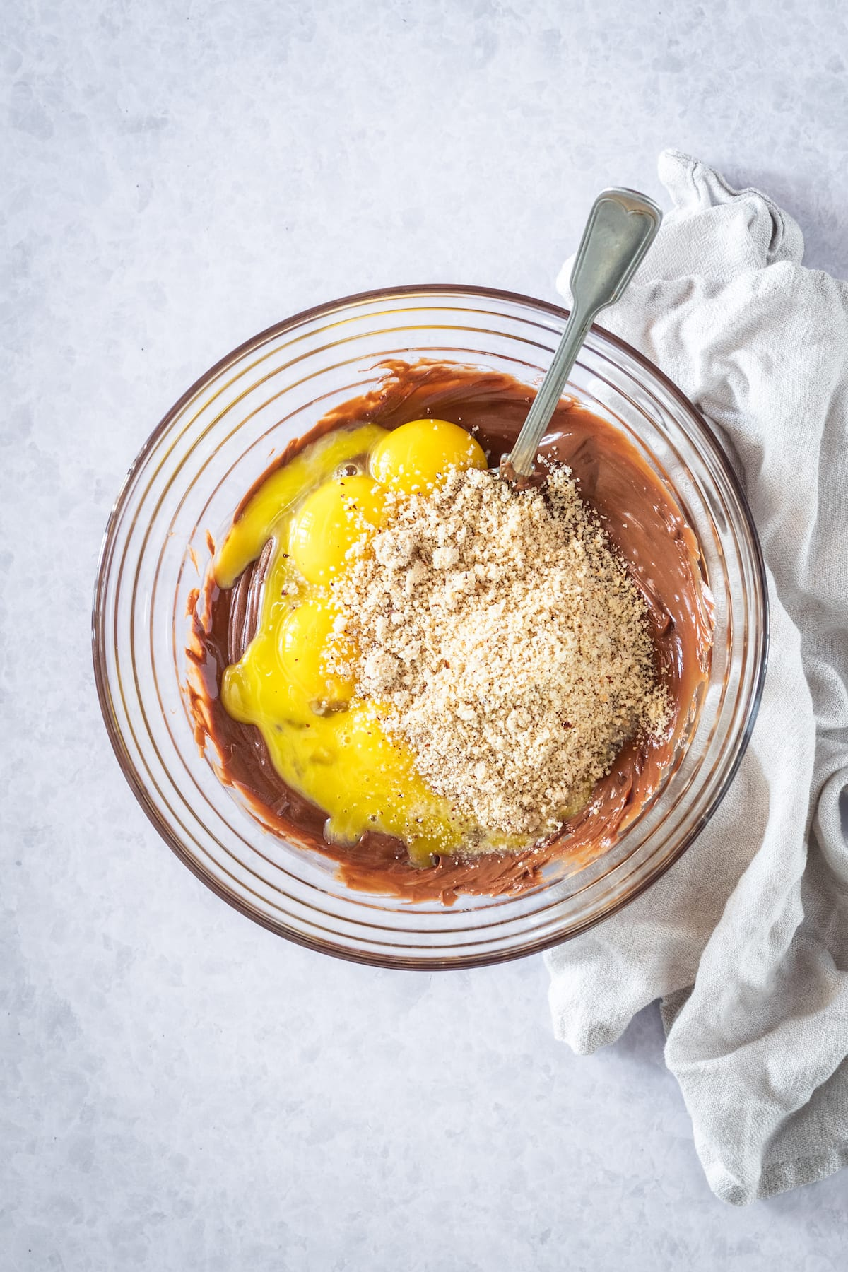 mixing bowl with egg yolks, ground hazelnuts and chocolate