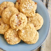 overhead view of Caramel Cashew Cookies on a blue plate