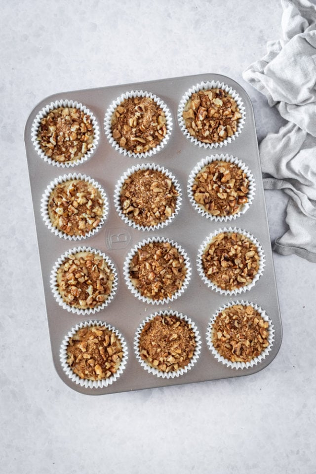 overhead view of Sour Cream Coffee Cake Muffins in a muffin pan