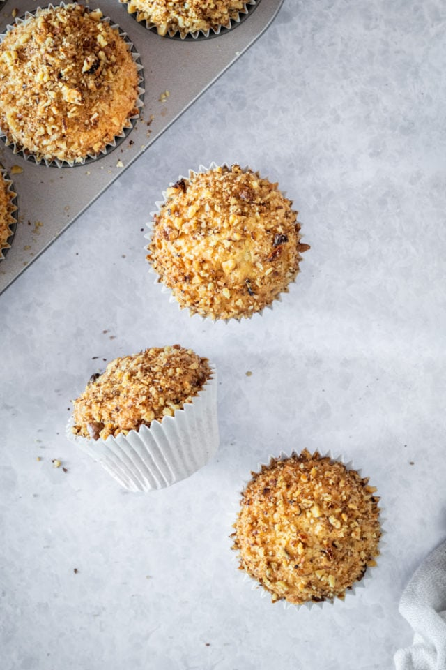 overhead view of coffee cake muffins on a light gray surface