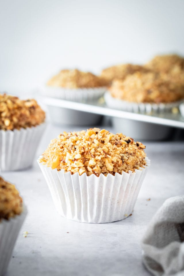 Sour Cream Coffee Cake Muffins on a light gray surface