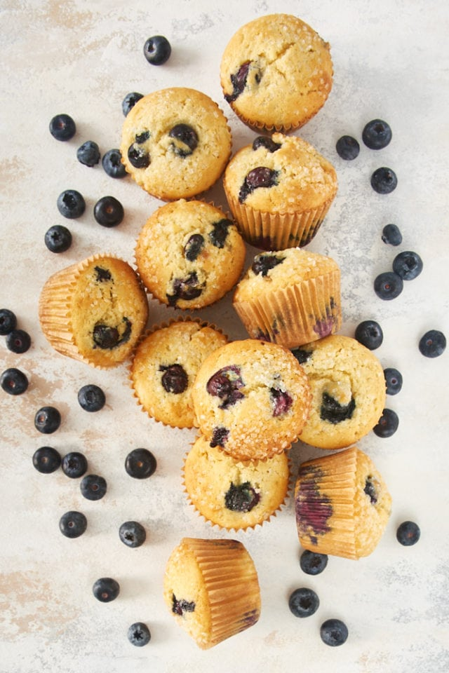 overhead view of Pineapple Blueberry Muffins on a beige surface