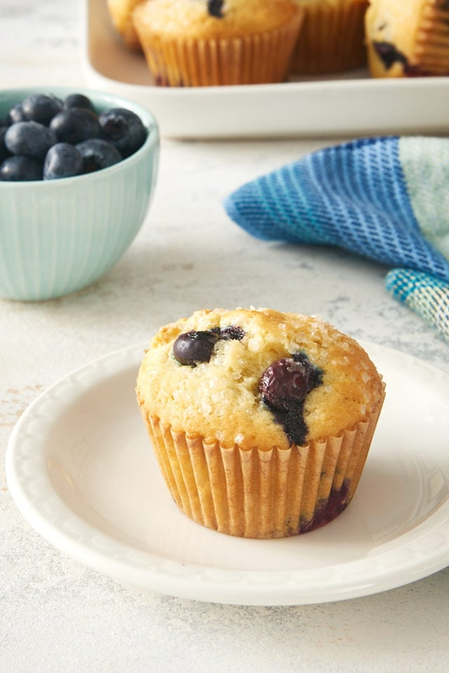 a Pineapple Blueberry Muffin on a white plate