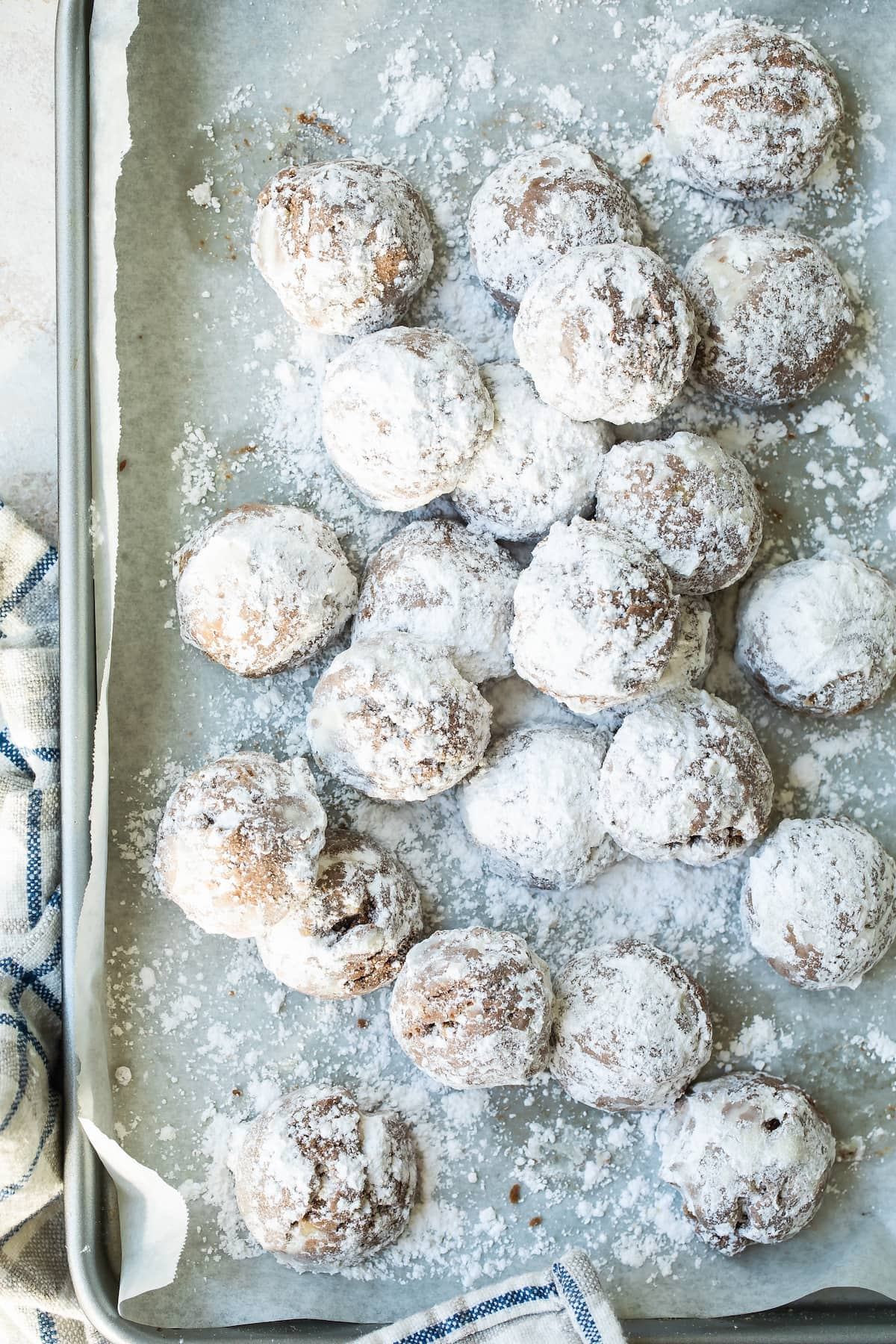 baking sheet of cocoa sandies with powdered sugar