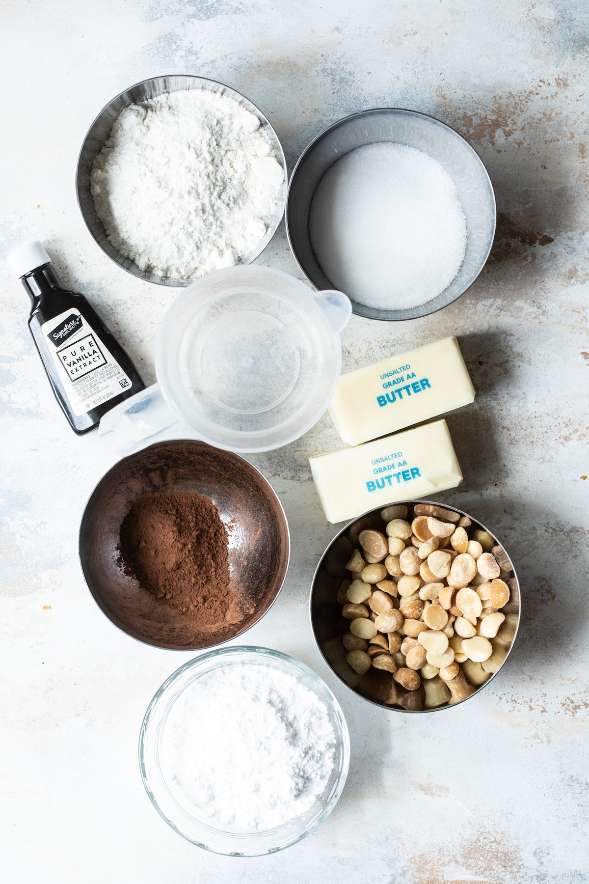 ingredients for cocoa macadamia nut sandies with butter, sugar, flour and nuts