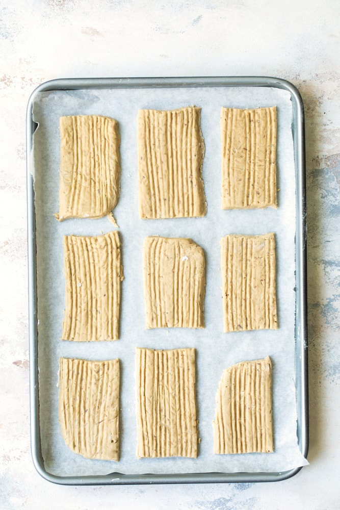nine washboard cookies on a rimmed baking sheet