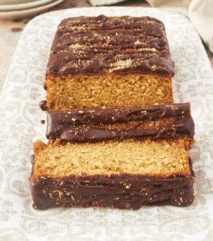 sliced Graham Cracker Cake on a beige and white platter