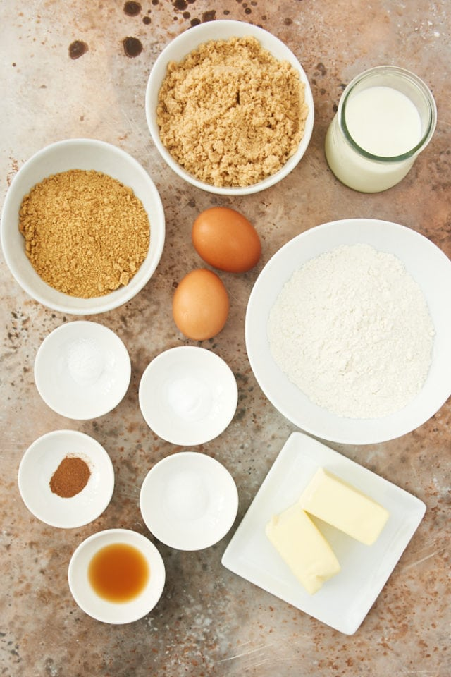 ingredients for graham cracker cake, including graham cracker crumbs, brown sugar, butter, and eggs