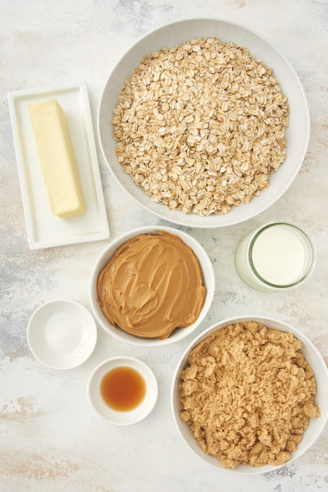 ingredients for no bake peanut butter oatmeal cookies, including oats, peanut butter, butter, and vanilla extract
