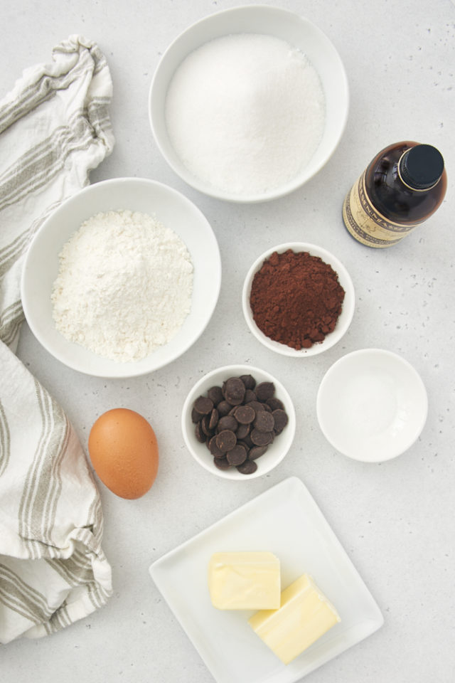 ingredients for brownies, including flour, cocoa, sugar, vanilla extract