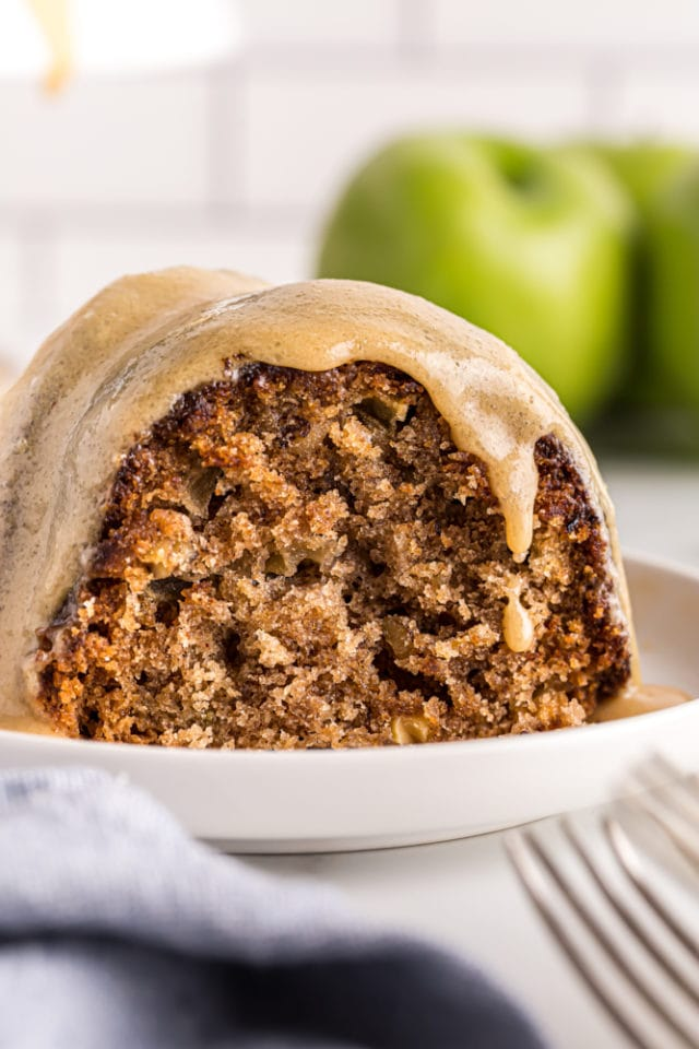 close up view of a slice of Apple Spice Cake on a white plate