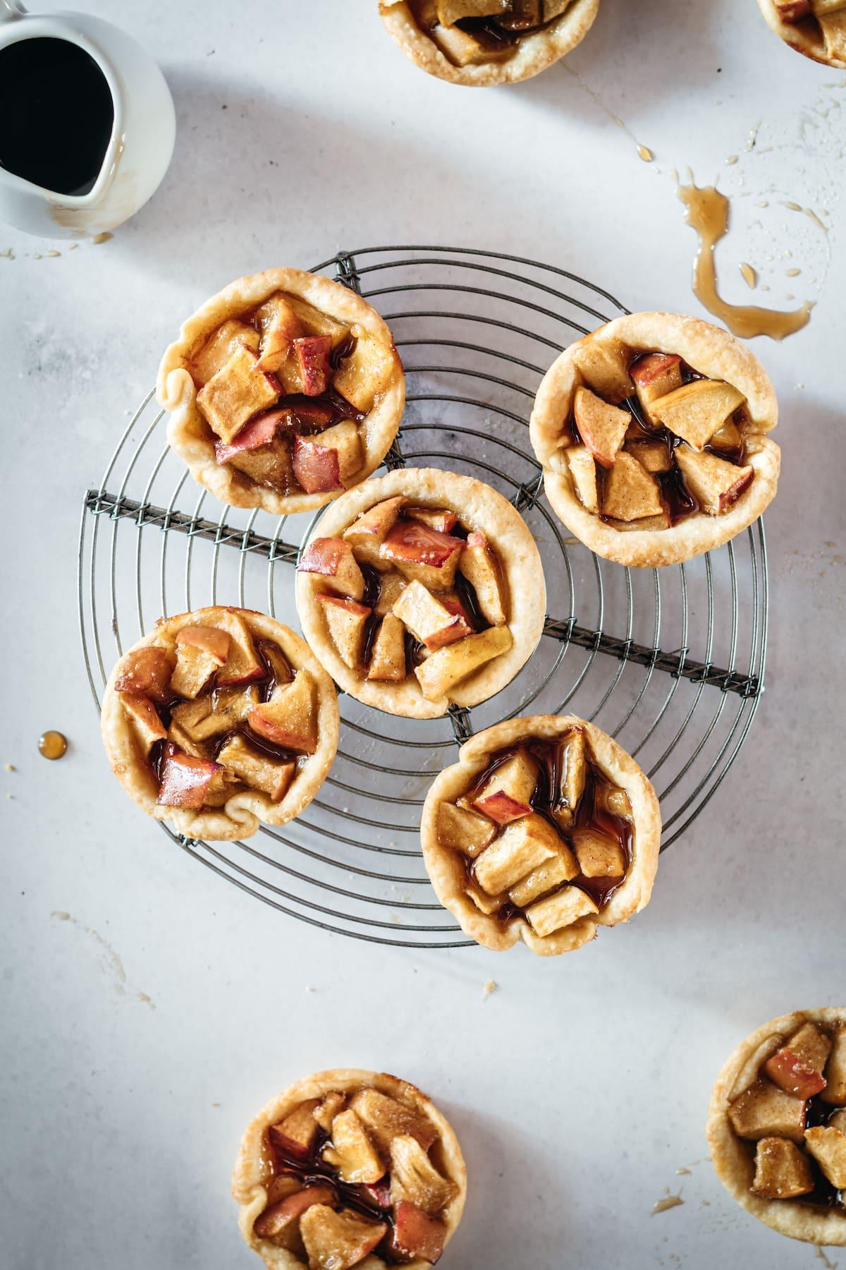 Overhead shot of Mini Caramel Apple Pies on cooling rack