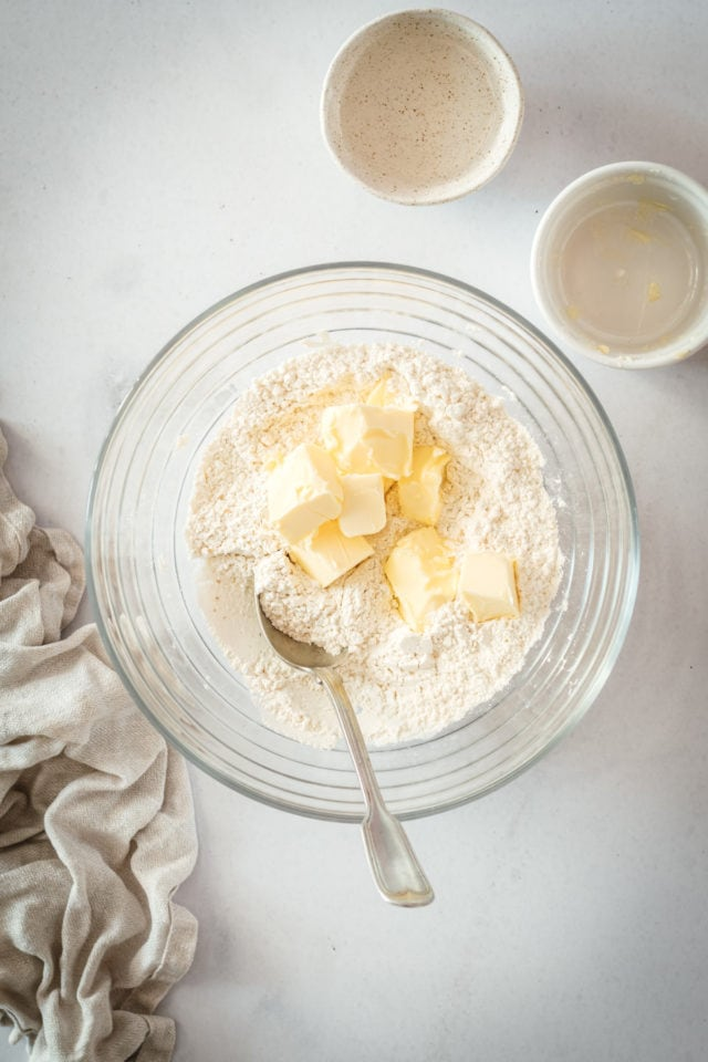 Overhead shot of flour and butter in glass bowl