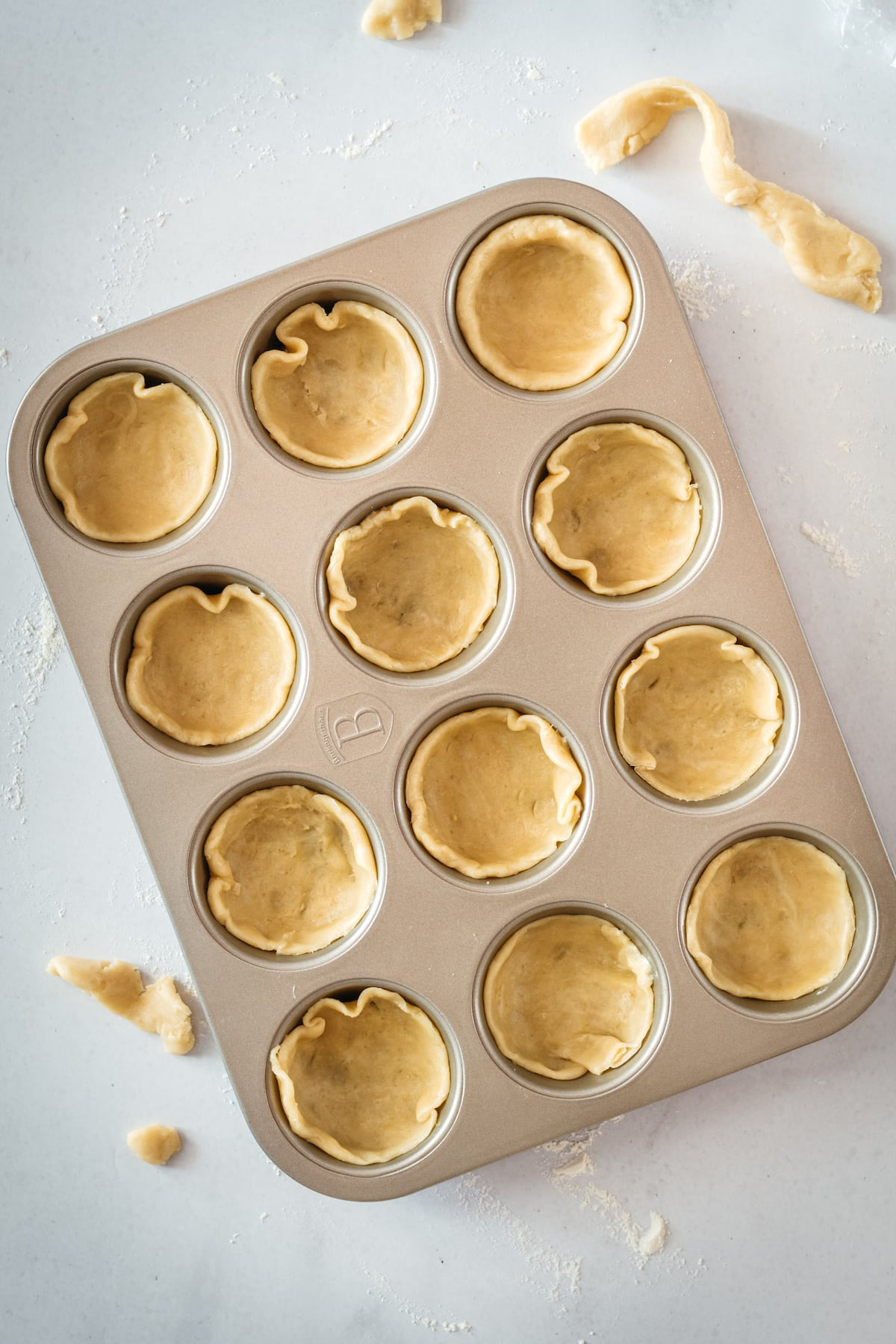 Overhead shot of pie crusts in muffin tin