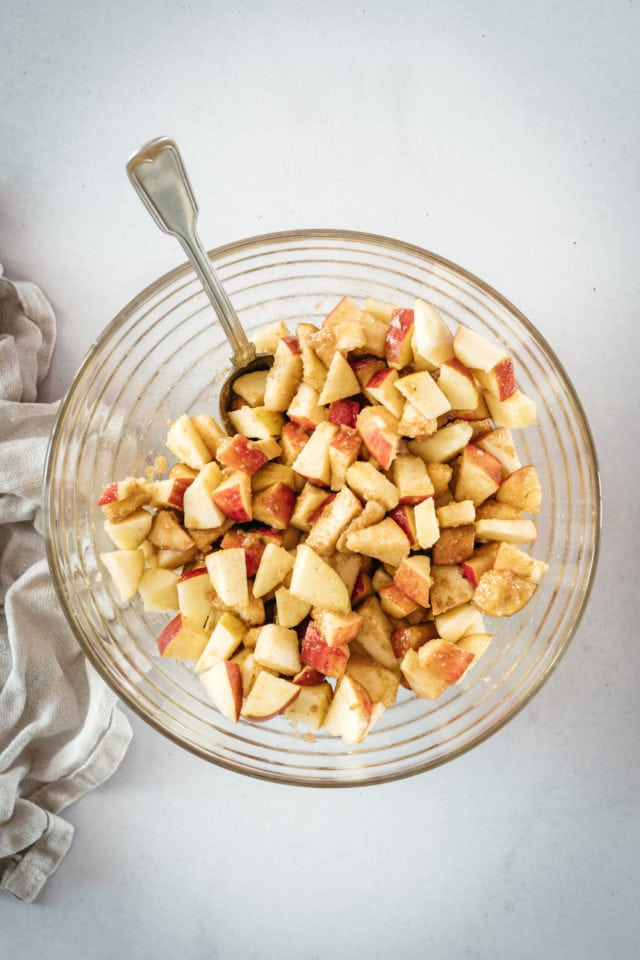 Overhead shot of apple pieces in glass bowl