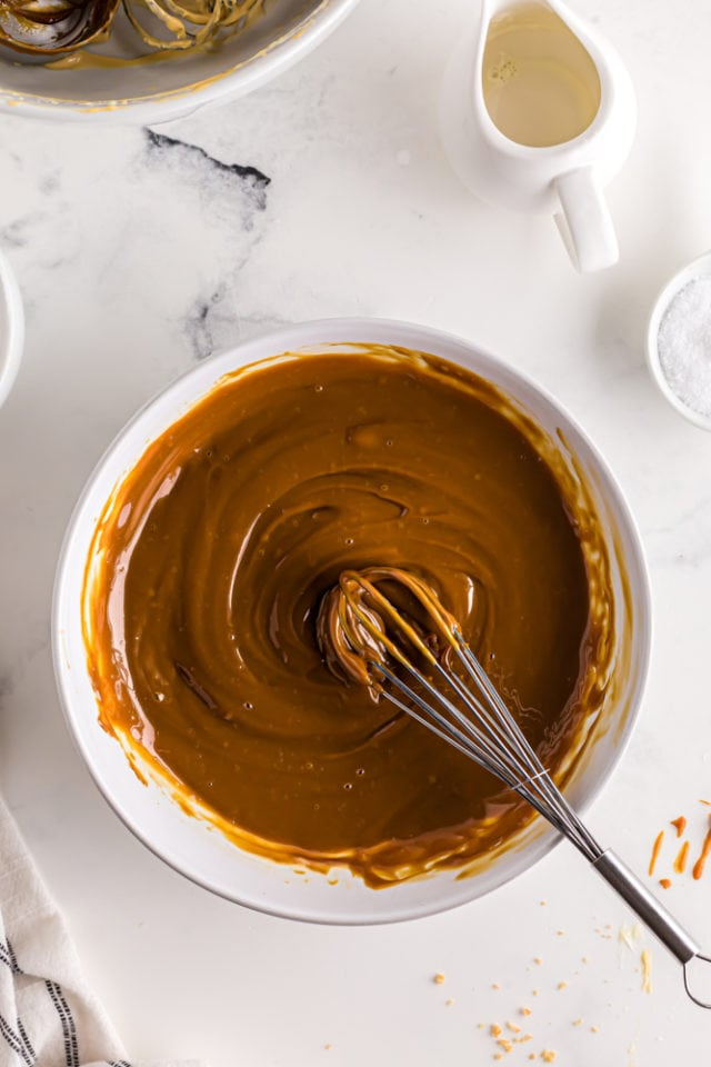 overhead view of dulce de leche glaze in a white mixing bowl