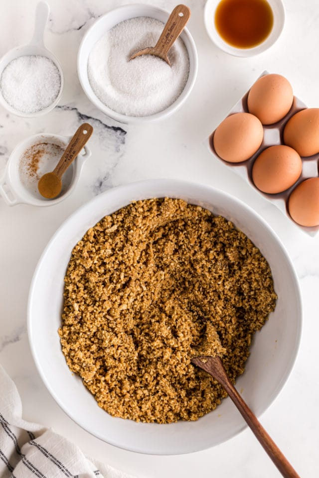 overhead view of graham cracker crust mixture in a mixing bowl