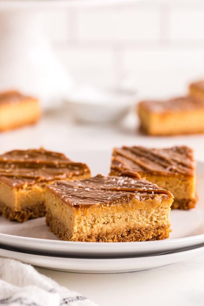 sliced Dulce de Leche Cheesecake Bars on a white plate