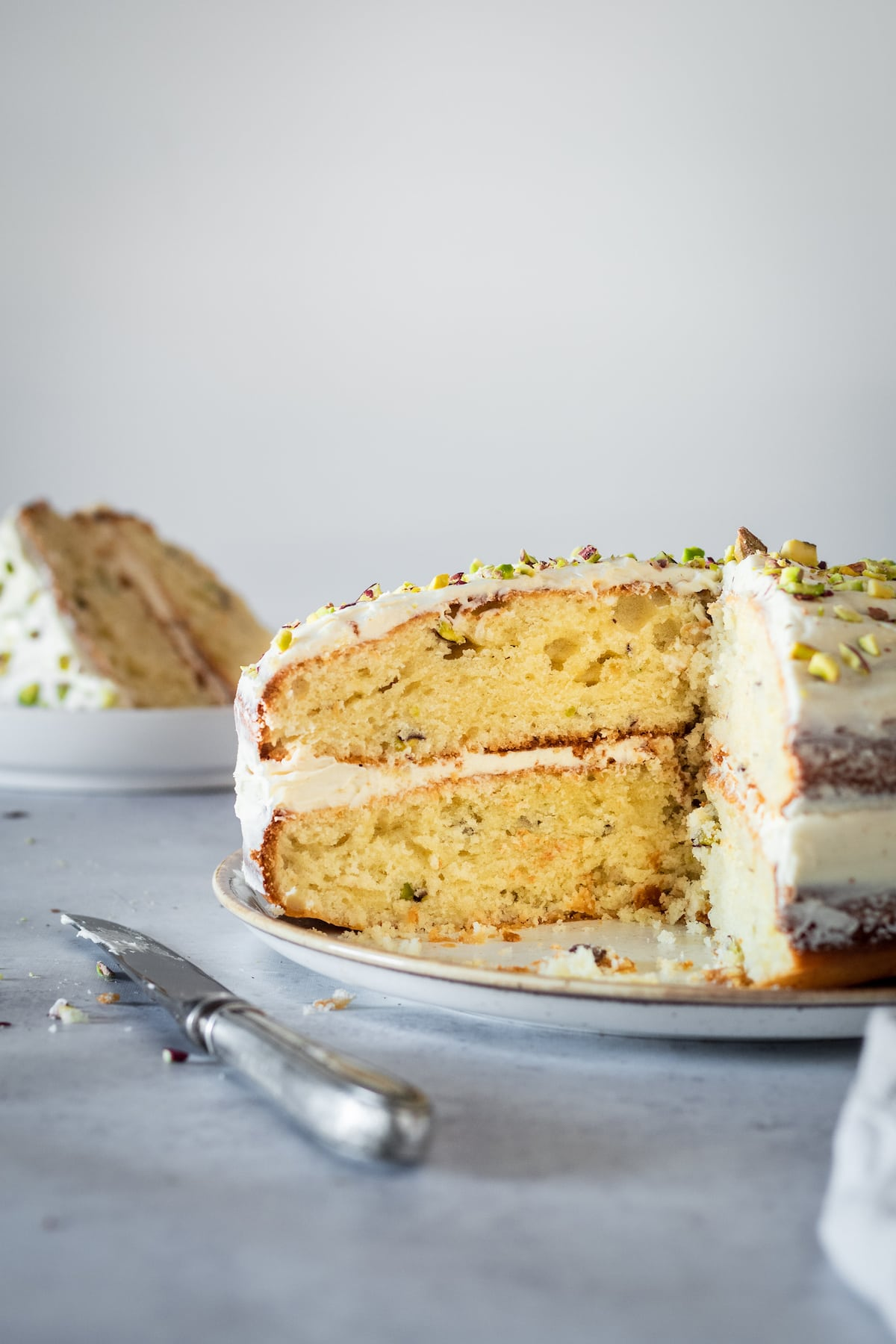 Pistachio Cake with two slices removed