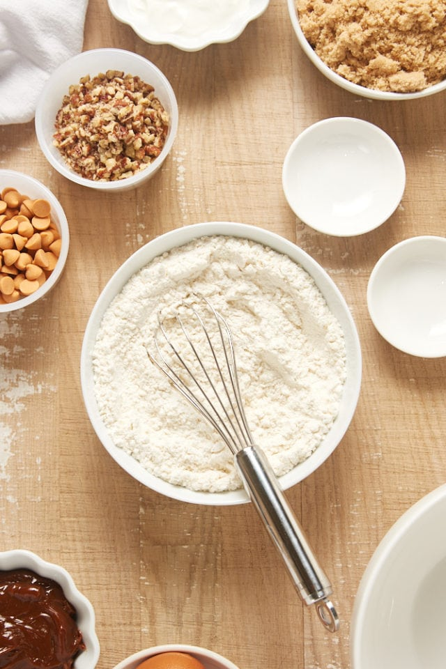 overhead view of dry ingredients mixed in a white mixing bowl