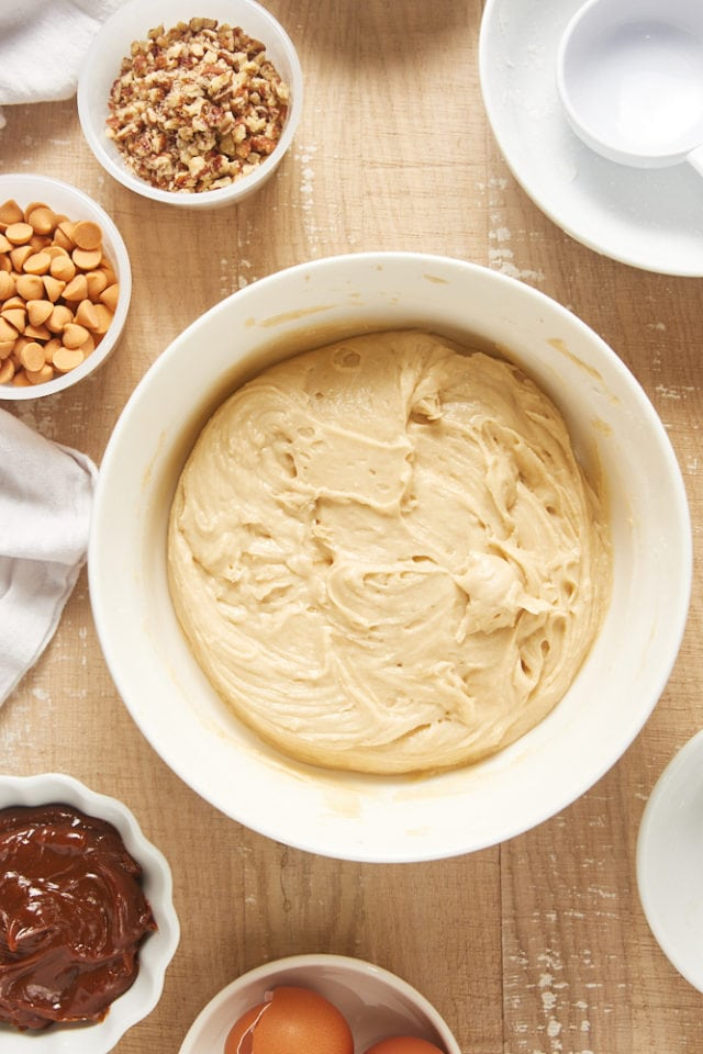overhead view of mixed brown sugar snack cake batter in a white mixing bowl