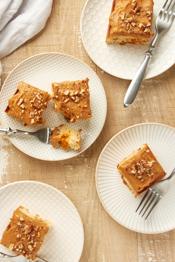 overhead view of Brown Sugar Snack Cake slices on white and beige plates