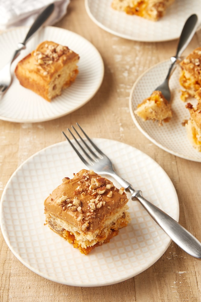 slices of Brown Sugar Cake on white and beige plates