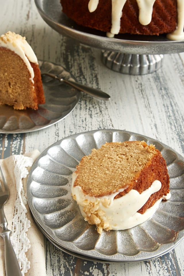 slice of Cinnamon Hazelnut Bundt Cake on a pewter plate