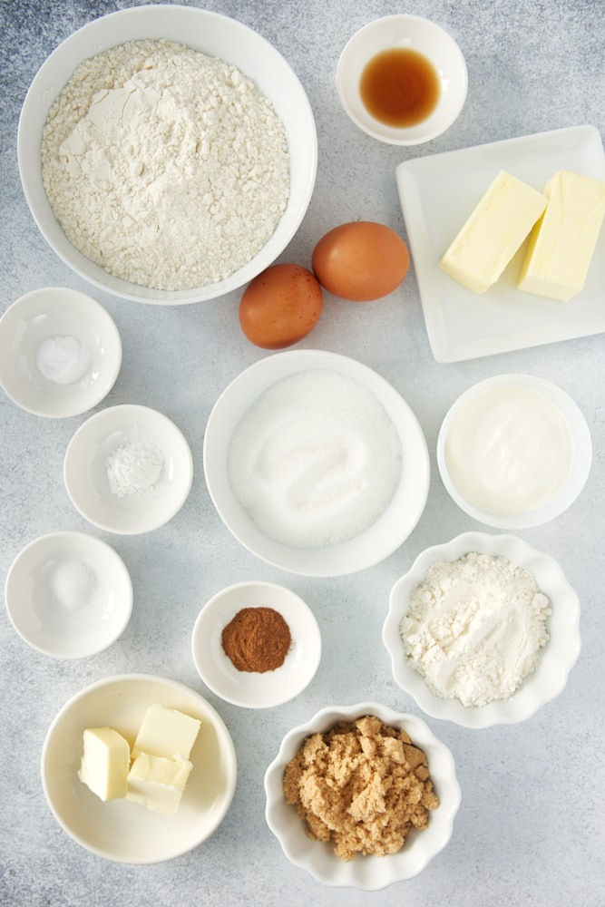 ingredients for coffee cake, including flour, sugar, butter, eggs, and cinnamon