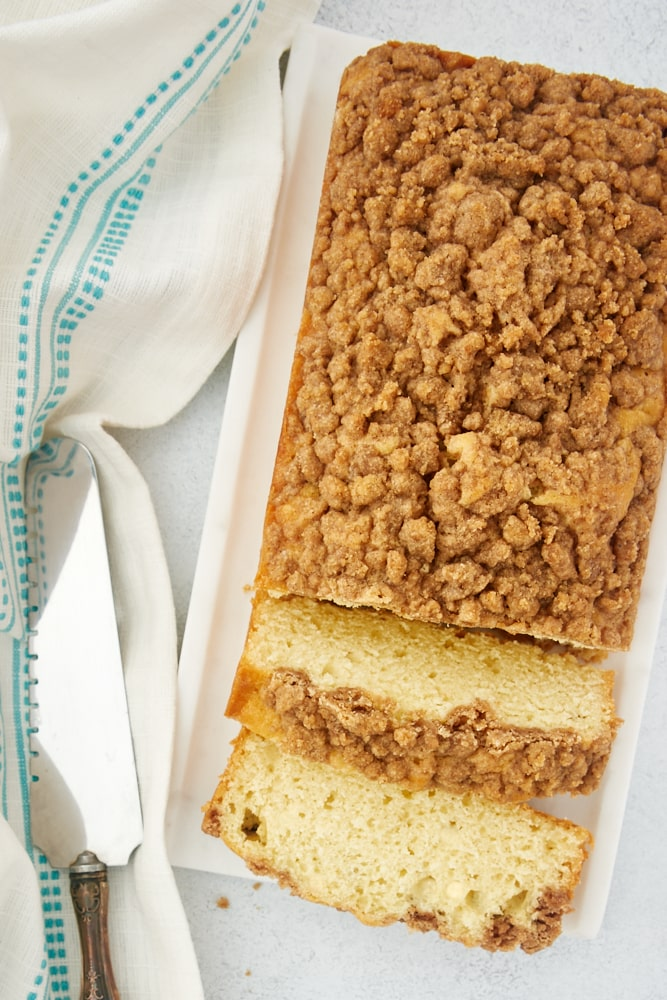 overhead view of Sour Cream Coffee Cake Loaf on a white tray